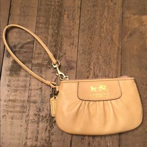 NWT Coach Wristlet in mustard color